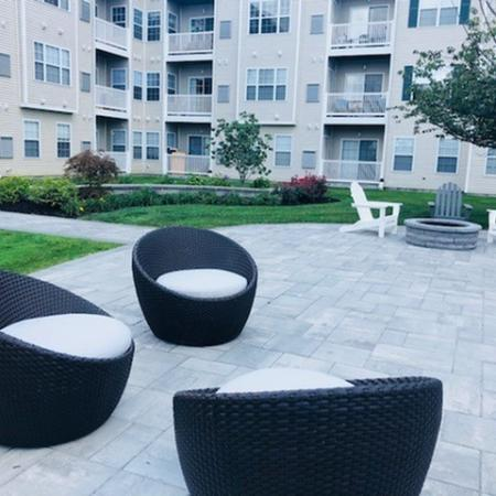 Patio seating | Outdoor common area | Highlands at Faxon Woods | Quincy apartments