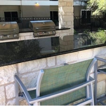Outdoor grills with bar seating | Northland at the Arboretum | Austin apartments