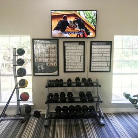 Free weights in apartment fitness center