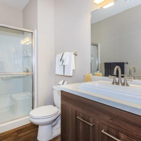 Master bathroom with hardwood flooring, wood cabinets and white countertops | Canyons at Linda Vista Trail