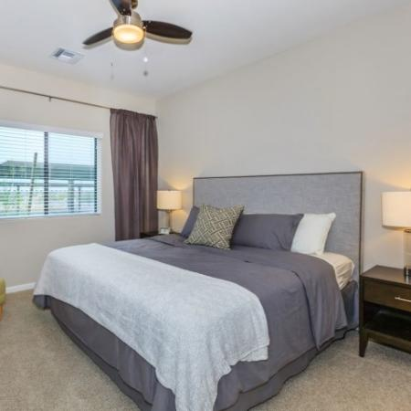 Bedroom with carpet flooring and updated ceiling fan | Canyons at Linda Vista Trail