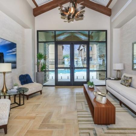 Clubhouse seating with view of pool | Canyons at Linda Vista Trail apartment community