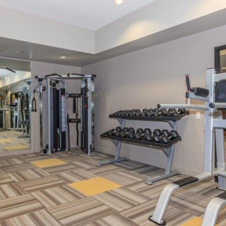 Free weights in apartment fitness center | The Canyons at Linda Vista Trail