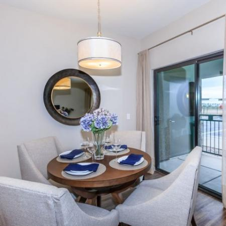Dining Room with sliding glass doors to balcony | Canyons at Linda Vista trail apartments in AZ