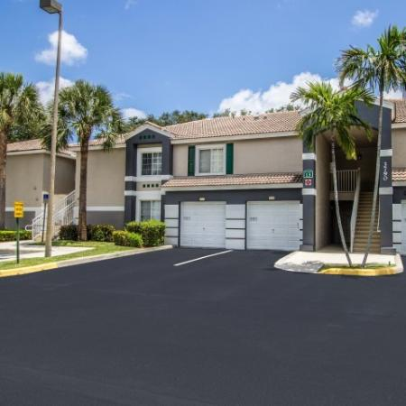 Exterior of Gateway Club apartments in Boynton Beach | attached garages available