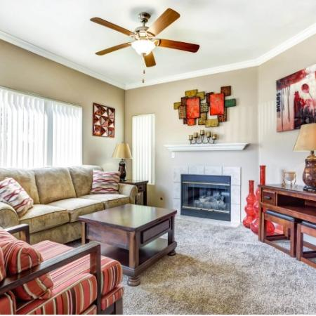 Living Room with corner fireplace | Links at High Resort in Rio Rancho NM