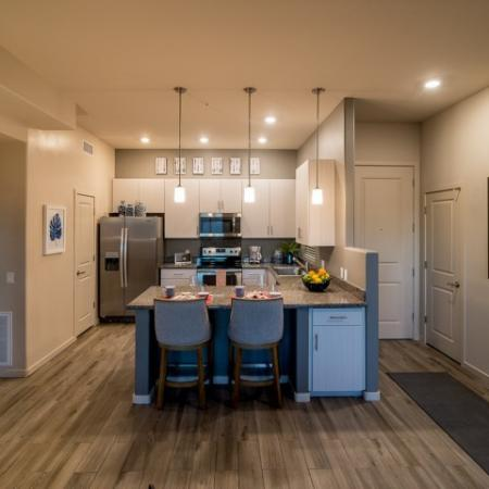 Kitchen with granite countertops, Stainless steel applicances, white cabinets | Pima Canyon Apartments