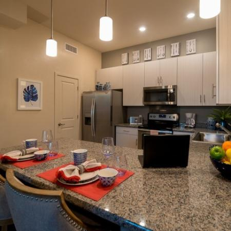 Granite countertops and white cabinets in Pima Canyon apartments