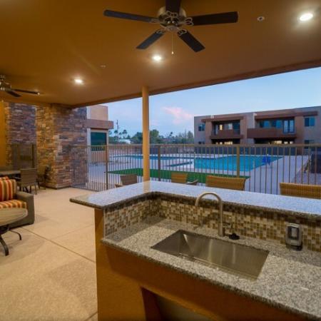 poolside seating | Pima Canyon apartment pool