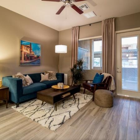 Living room with hardwood floors, ceiling fan | Tucson AZ Pima Canyon apartment