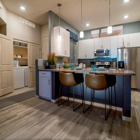 Kitchen with granite countertop, stainless steel appliances | Pima Canyon one bedroom apartment