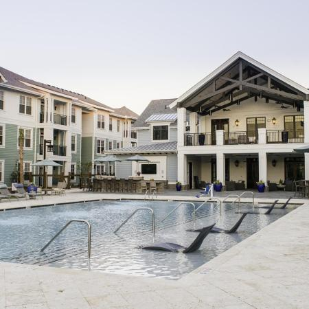 pool with tanning ledge and tanning chairs | Wharf7 | Daniel Island apartment complex