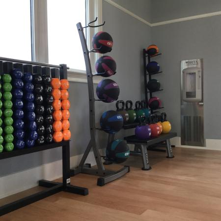 yoga studio with weight equipment | wharf 7 apartments