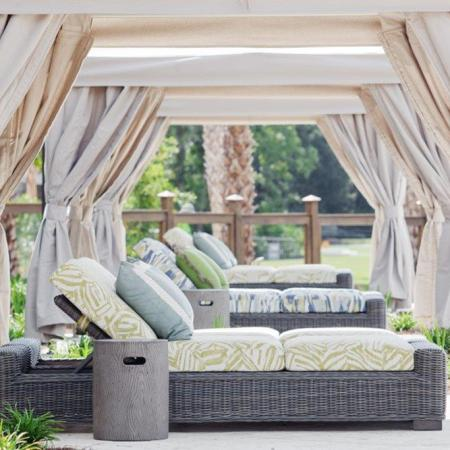 poolside cabanas with lounge chairs and sun shade | Wharf7 | Charleston apartment complex