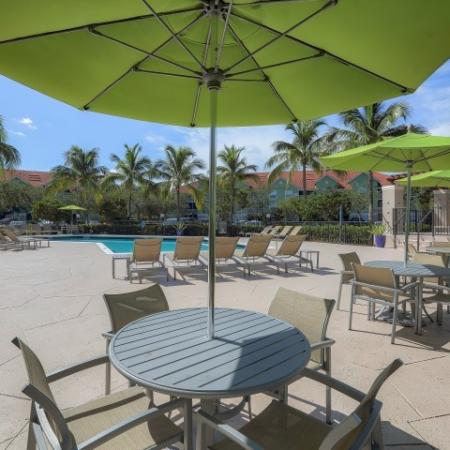 Poolside tables and chairs | Monterra at Bonita Springs apartment complex