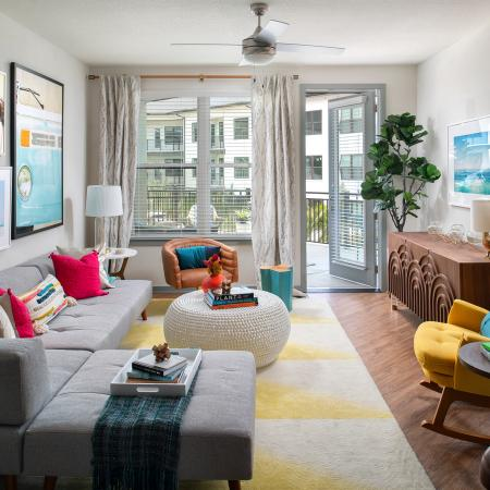 living room opening to private balcony | The District at Rosemary | apartments | FL