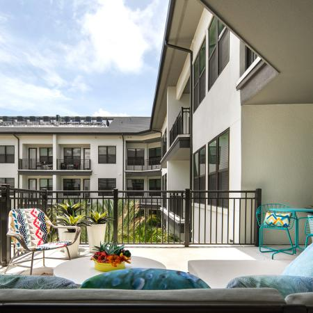 Private balcony overlooking pool | 1 bedroom apartment | The District at Rosemary