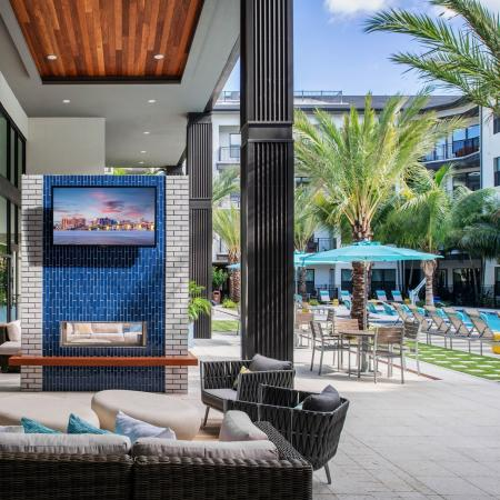 poolside seating with outdoor tv | The District at Rosemary