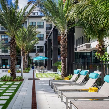 poolside lounge chairs | apartment | The District at Rosemary complex | Sarasota FL