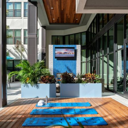 outdoor shaded yoga patio | apartment community | Sarasota FL | Rosemary district