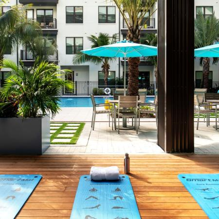 outdoor yoga patio | The District at Rosemary rental community