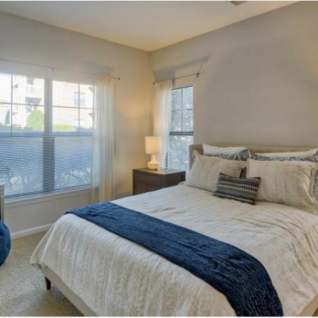 Master bedroom with carpet and large windows