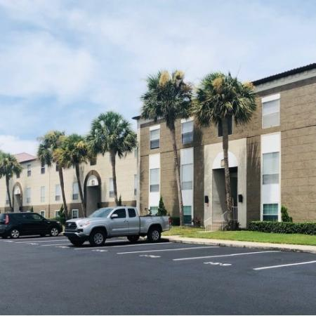 Exterior of The Brittany apartment homes with parking in front of entrances