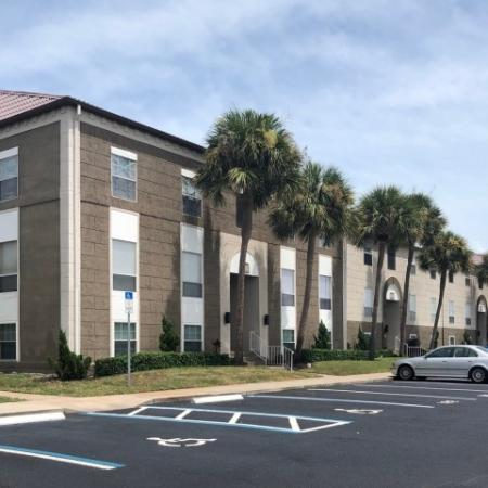 Exterior of 3 story apartment buildings at The Brittany in Indialantic FL