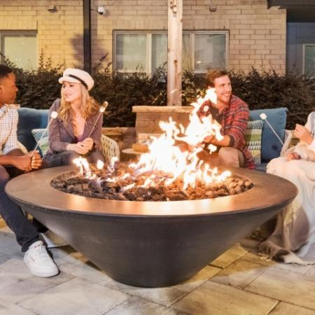 Fire pit with lounge chairs  | Inspire apartment community