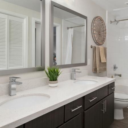 renovated apartment home | Lodge at Lakeline | quartz counters, espresso cabinets, wood flooring