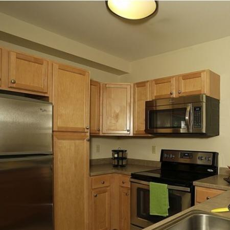 Kitchen with stainless steel appliances and blonde cabinetry