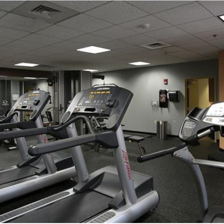 Residences at Manchester Place fitness center with cardio equipment