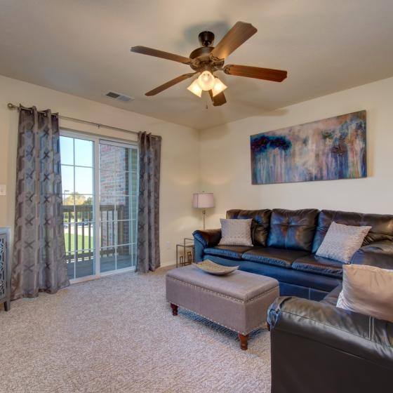 Interior furnished apartment with carpet, Hawthorn Suites