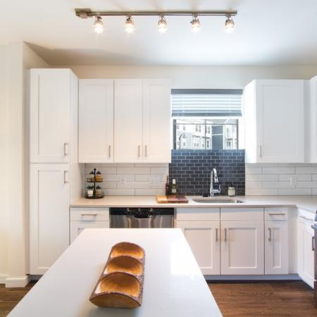 Modern Kitchen with Quartz Counters, Subway Tile and Stainless AppliancesModera Natick Center