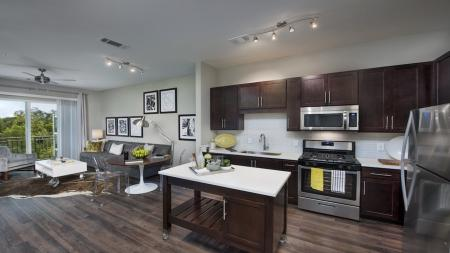 Modern Kitchen with Moveable Island and Wood Plank Style Floors | Modera Morningside