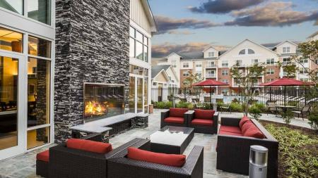 Outdoor Deck with Fireplace and Lounge   Modera Westside
