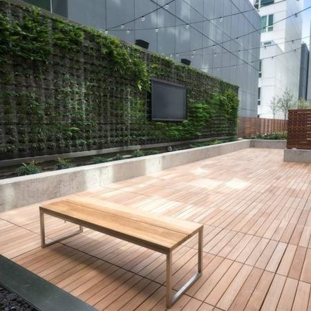 Ground Floor Terrace with Outdoor Seating and Television | Modera Capitol Hill