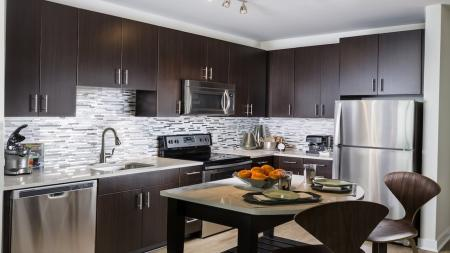 Modern Kitchens with Moveable Islands, Quartz Counters and Tile Backsplash   Modera Fairfax Ridge