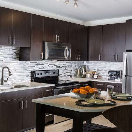 Modern Kitchens with Moveable Islands, Quartz Counters and Tile Backsplash | Modera Fairfax Ridge
