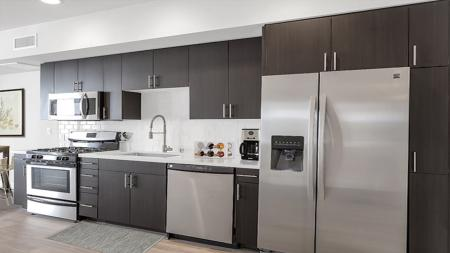 Modern Kitchen with Quartz Counters, Stainless Appliances and Luxe Finishes  Modera Glendale