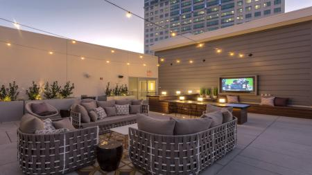 Outdoor Lounge with Seating and Flat Screen Television   Modera Glendale