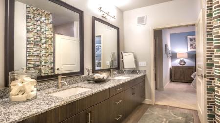 Granite Counters and Double Vanity in Bathroom | Modera Energy Corridor