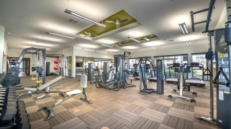 Expansive Fitness Studio with Cardio Machines | Modera Energy Corridor