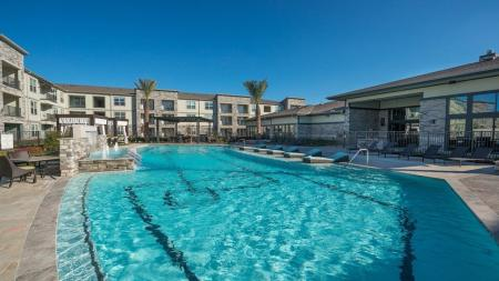 Outdoor Pool Area with Water Features | Modera Energy Corridor