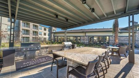 Outdoor Lounge with Grills and Dining Area | Modera Energy Corridor