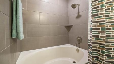 Large Soaking Tub with Tile Surround in Bathrooms | Modera Energy Corridor
