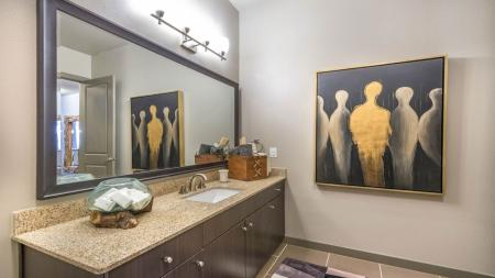 Granite Counters, Framed Mirrors and Modern Fixtures in Bathrooms | Modera Flats