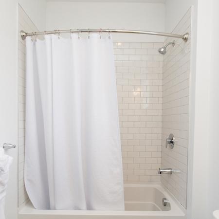 Large Soaking Tub with Curved Shower Bar | Modera Hopkinton