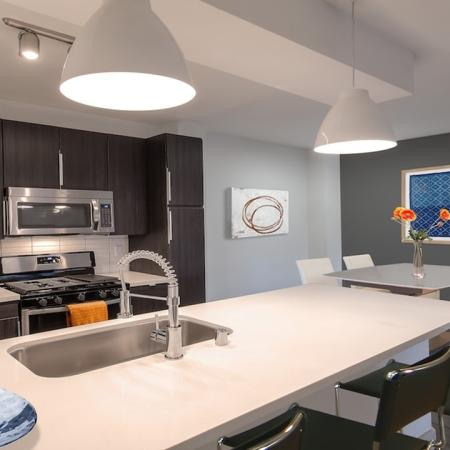 Modernized Kitchens with Quartz Counters and Stainless Appliances | Alister Sherman Oaks