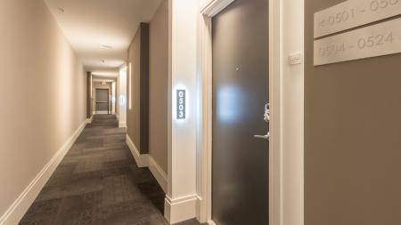 Backlit Apartment Numbers in Hallways | Modera Midtown